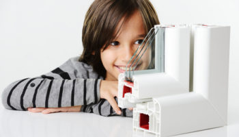 26353713 - kid holding plastic window profile